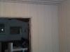 Nytapetserade väggen mot lilla sovrummet
